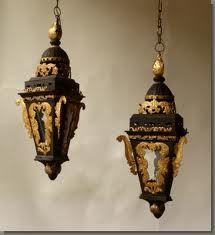 Black and gilt tole Baroque style gondola lanterns