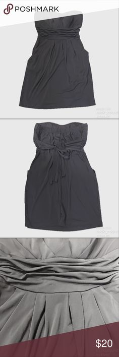 Strapless Dress With Pockets Just like my purple one listed. Super cute Strapless Stretch jersey type dress with Pockets and ties around back. Worn once. Wishes Wishes Wishes Dresses Mini