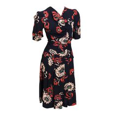 Floral print dress with lightly layered gathering at the waist and ties at back from Debbie Harry's vintage collection. Hits just at the knee   United States, 1940's