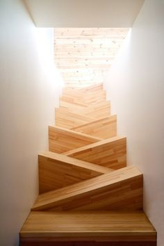 slanted wooden stairs take my breath away (yes I know the angle of the picture is looking down the stairs, but doesn't it look so fun??)