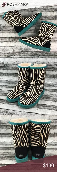 Zebra & Teal Classic Short Authentic UGGS Boots Authentic UGG Australia brand   Size women's 8  Zebra print w/ teal sole classic short boot with sheepskin fur lining. These are real animal hair & have a unique texture.  As such, the hair lays differently in different areas & there are also color inconsistencies. The boots were purchased new & sprayed with UGG protectant spray. They were worn a couple times & show very mild signs of wear / use. The soles have some minor dirt marks but almost…