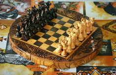 Handmade cherry wood chessboard with safari animal pieces. Find us on Etsy: https://www.etsy.com/uk/shop/BeautifulAfrican