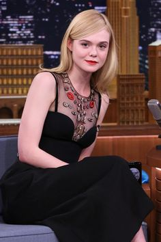 Elle Fanning in the heat of summer with poker-straight strands.