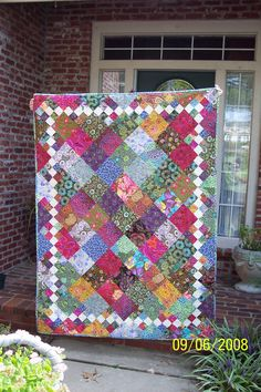 Pretty quilt! Notice the 9-Patches around the edges to create the white border blocks.