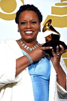 Dianne Reeves Photos - Singer Dianne Reeves, winner of Best Jazz Vocal Album for 'Beautiful Life,' poses in the press room during The Annual GRAMMY Awards at the STAPLES Center on February 2015 in Los Angeles, California. Iconic Women, Famous Women, Dianne Reeves, Like Fine Wine, Awards, Football, Artists, Music, Room
