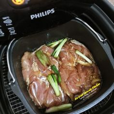 Arrange marinated chicken with skin side down in the air-fryer baking pan