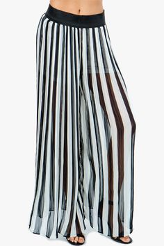Sweeping striped bottoms with a wide-leg palazzo pant silhouette. Pleated body. Elastic waist. Partially lined. BOUTIQUE FIVE.