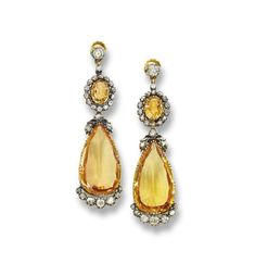 A PAIR OF ANTIQUE TOPAZ AND DIAMOND EAR PENDANTS  Each detachable pendant, set with a pear-shaped topaz, with old-cut diamond detail, suspended from an oval-shaped topaz top within an old-cut diamond surround, mounted in silver and gold, 6.0 cm long, circa 1880 (3)
