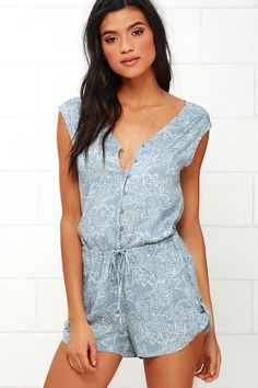 Take a step out of your door in the Black Swan Clariee Blue Print Romper and be welcomed by compliments! Super soft and lightweight woven rayon, with a blue grey and ivory print, shapes a sleeveless bodice with a V neckline and button placket. Tying drawstring waist, with gunmetal beads, tops the loose shorts with button tabs.