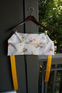 pocket apron made from a pillow case and some ribbon