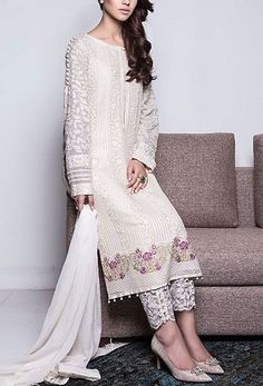 White Salwar Kameez suits are an evergreen variety in the ethnic wear segment! These versatile dresses can be styled in any way to make you look effortlessly stunning. Check out the top designs here! Indian Attire, Indian Ethnic Wear, Pakistani Outfits, Indian Outfits, Pakistani Salwar Kameez, Indian Kurta, Churidar, Anarkali, Salwar Designs