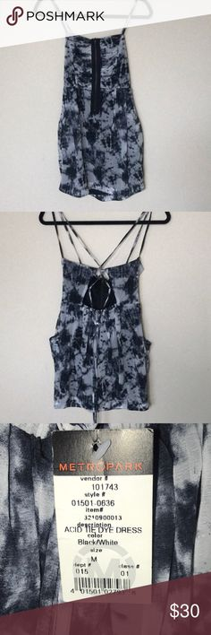 Black and white tie dye dress with pockets This cute dress has a functional zipper in the front, laces up the back and has pockets making it perfect for a festival or summer concert. Black Dresses Mini