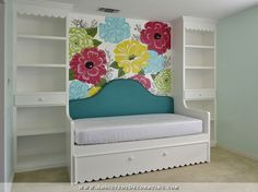 Love how this DIY built-in trundle day bed and shelves came out for this teenager's room.