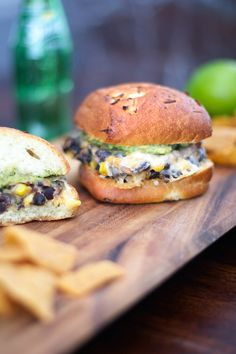 Black Bean Burgers with Hummus and Guacamole, serve with extra hummus and plenty of guacamole. And don't forget the onion bun!