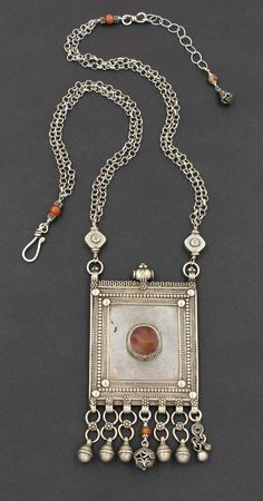 A spectacular antique silver Yemen amulet pendant with old Yemeni silver beads, antique carnelian on sterling silver chain. A bold statement necklace and one of a kind. Modern ethnic jewelry by Angela Lovett Designs