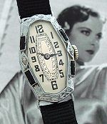 "Mesmeric ladies Deco-Era ""wristlet"" watch in a solid 14k white gold case, garnished with diamonds and sapphires — circa early '20s."