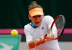leads on day 1 of the 2014 Group Playoffs Tie. Simona Halep overcame a rain-delayed rubber to def. Fed Cup, Simona Halep, Tennis Racket, A Team, Madrid, Adidas, Sports, Rain, Group