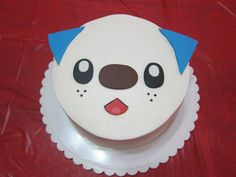 Oshawott Cake.  Iced in buttercream and fondant accents.