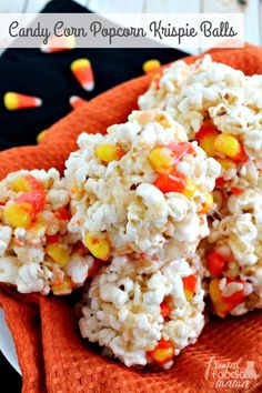 These sweet & salty Candy Corn Popcorn Krispie Balls are the perfect easy to make treat for a fall or Halloween celebration. #popcornballs #candycorn #halloweenrecipe