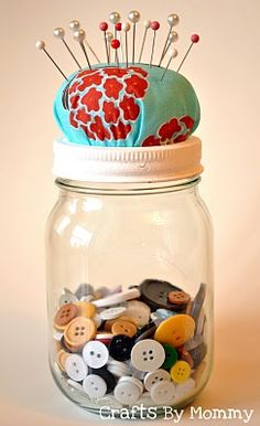 I have one of my great-grandmother's old jars filled with her buttons. No pin cushion on top.