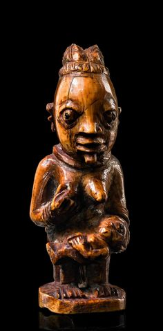 Africa   Maternity figure from Owo, Yoruba people, Nigeria   Ivory with a hony brown patina