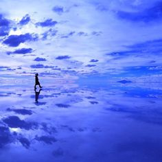"""Travel far enough, you meet yourself."" – David Mitchell There aren't many places on earth where it's nearly impossible to distinguish where the ground ends and the sky begins. @kenta0930 walks on water in #Bolivia. #traveltuesday #travelbucketlist #travelzoo"