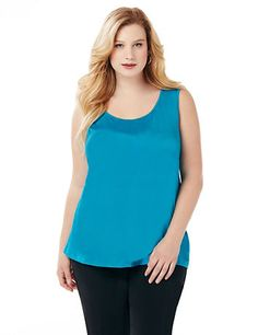 We've updated our bestselling layering tank with a touch of extra length, for better coverage without being too long. Scoopneck style features silky, stretch knit fabric for complete comfort. Bust darts offer added fit at the armholes. Comes in an assortment of solid colors for mix-and-match possibilities. catherines.com