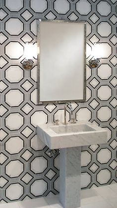 For the bathrooms, I would definitely go wild with tile...using all Ann Sacks marble patterns. Geometrics in greys, blacks, whites.