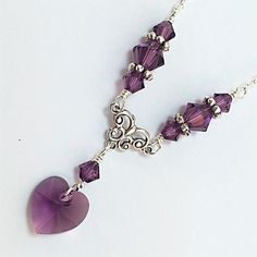 A personal favorite from my Etsy shop https://www.etsy.com/listing/96190580/new-swarovski-amethyst-heart-charm
