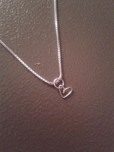 This necklace has a small sterling silver plated copper heart with a .999 sterling silver plated brass chain. The venetian chain is 18 inches. The heart is 3/4 inches long and wide. This necklace is simple enough to wear by itself or with layers of necklaces. Buy yours at https://www.etsy.com/listing/197417638/simple-love-necklace?ref=shop_home_active_4
