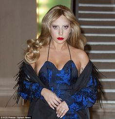 Bizarre: Lady Gaga stepped out in Paris on Saturday night sporting bleached eyebrows and i...