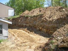 Excavating behind a sunroom addition