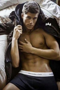 Ok this guy is hot but what's with the arm that's awkwardly draped across his body??