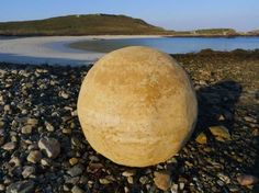 Andy Goldsworthy's Massive Clay Alderney Stones Conceal Found Objects