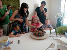 Smashing the pinata cake with a toy hammer