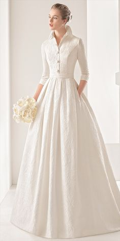 Classic tailored three-quarter-sleeve silk brocade dress with open button collar and pleated skirt, in natural.