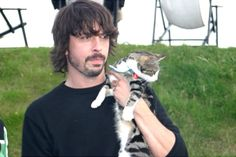 dave and kurt both seem to have a thing for taking pictures with cats.
