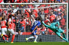 Thibaut Courtois is helpless to stop the screamer from Alex Oxlade-Chamberlain, giving Arsenal the victory over Chelsea.