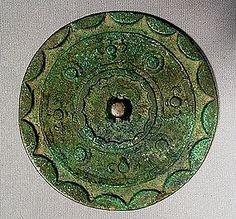 CHINESE BRONZE MIRROR, HAN DYNASTY (206 BC-220 AD)