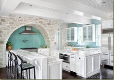 would love a little light teal accent color in my future kitchen with the white cabinets and dark espresso floors. I just love the stone wall!!