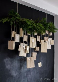 Simple Christmas decor.  Cedar garland with tiny presents wrapped in craft paper, hanging from the cedar garland