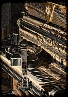 .antique piano with vintage guitar