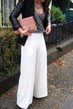 A combination of strong neutrals. I could go for a wide-leg flare pant such as this. The little pop of colour in the clutch doesn't hurt either.