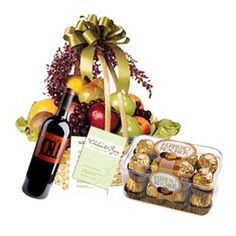 Greet him and her for personal milestones or achievements with a card. The best way to hail him/her is by the traditional way of giving fruit gifts, added with fresh chocolate flavors such as Ferrero Rocher. And for adding warmth, red wine is very much there. The gift basket contains a Greeting Card, red wine, 2 kg. fruits basket, and Ferrero Roecher (16 piece box).Note:.You can mention the special occasion during the checkout process so that we send out an appropriate greeting card.