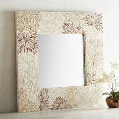 Our handcrafted mirror offers more than just a reflection. With its natural capiz shell mosaic of bursting florals and smooth lacquered finish, it's an art piece in its own right.