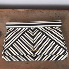 Givenchy Clutch Black and cream geometric soft leather clutch worn several times. Has a cool round top to hold on to so you don't have to keep it under the arm. Light stains on front and some darker stains on the lower right of the back. Givenchy Bags Clutches & Wristlets