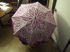Crochet Umbrella Cover - love the concept, and beautiful execution, but would it get totally wrecked the first time it rained?  Maybe it's really a parasol?