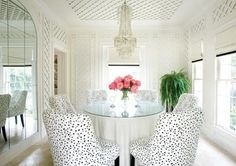 lattice walls animal print chairs mirrored dining room glass table