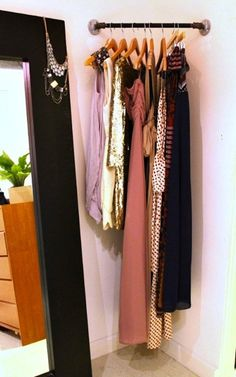pipe and flange clothes rod / storage 25 DIY Projects for Small Bedrooms