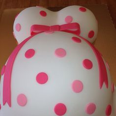 Pregnant belly cake,add baby blocks spelling her name....